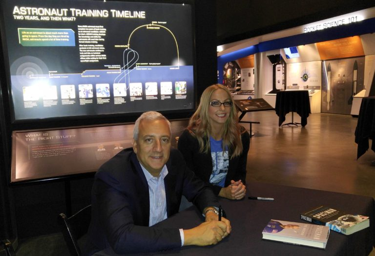 Mike Massimino and Lesley Haenny, with a copy of both the American and British versions of his book on the table. (Photo Credit: Lesley Haenny)