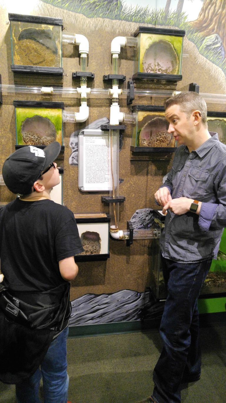 Jordan Krushen talking to a guest about the ant colony. (Photo Credit: Lesley Haenny)